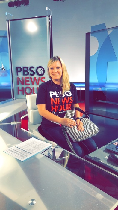 Mrs. Horner sitting at the anchor desk at the PBS News Hour in Washington, DC