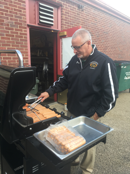 Dr. Curry grilling hotdogs for Open House